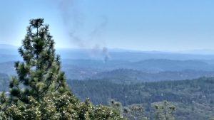 80 fire as seen at 11:48 am from Wolf Mountain lookout. Photo: Julie Siegenthaler