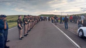 Officers from the Morton County Sherriff's Dept. line up facing Dakota Access Pipeline protesters in North Dakota, August 15. Via Standing Rock Dakota Access Pipeline Opposition on Facebook.