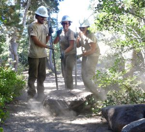 It's dirty work, but Conrad Kempsky, Lindsey Johnson and Halle Lambeau did not shy away from the team work and coordination it takes to move these granite boulder across the landscape to the project site. The granite boulders can weigh up to several hundreds of pounds and cannot reasonably be lifted by hand and moved. USFS photo