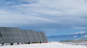 The amount of energy gathered by solar panels — such as these in Colorado's San Luis Valley — is influenced by factors including the position and types of clouds, the amount of snow on the ground, and relative humidity. The new Sun4Cast system greatly improves solar irradiance predictions, enabling utilities to deploy solar energy more reliably and inexpensively. (©UCAR. Photo by Sue Ellen Haupt, NCAR. )