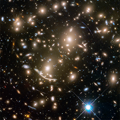 Hubble Captures Massive Galaxy Cluster In Stunning Detail