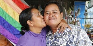 Changing families give rise to needed policy changes. Sao Mimol kisses her partner in Cambodia during an LGBT Pride event.